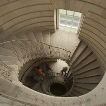 Visitors on the stone spiral staircase at Seaton Delaval Hall, Northumberland